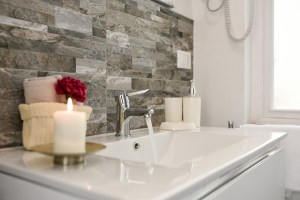 A faucet lined with candles used to stage your home.