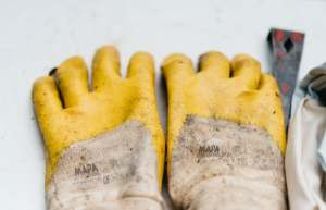 pair of brown-and-yellow leather gloves