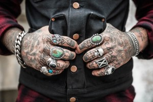 pack jewelry for the move - man's hands with rings