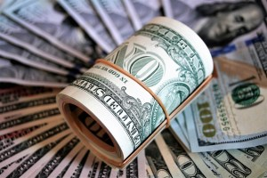 A stack of dollar bills to pay for movers Haddonfield NJ.