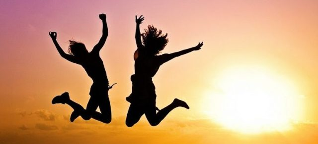 women jumping from joy with Riverdale movers