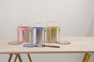 a picture of three paint cans on the table