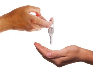Two hands and a house key