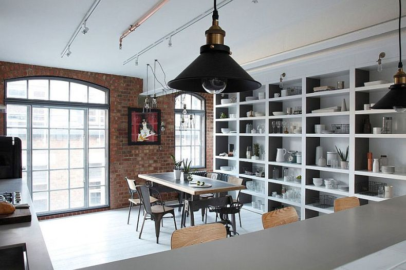 Kitchen-and-dining-room-of-the-industrial-London-home-with-a-brick-wall