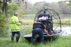 Pct. 5 Constable David Hunter and Tarkington firefighter Albert Crawford prepare to launch an airboat in Sam Houston Lake Estates on Tuesday.