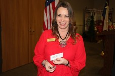 """Tonya Smikal holds up the note she received in a """"Naughty or Nice"""" game at the Dayton Chamber luncheon on Dec. 4. The note said she was naughty for not attending enough Business After Hours events held by the chamber."""