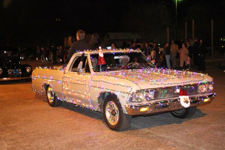 Hundreds of lights adorn this antique car for the Country Christmas parade in Liberty on Nov. 27.