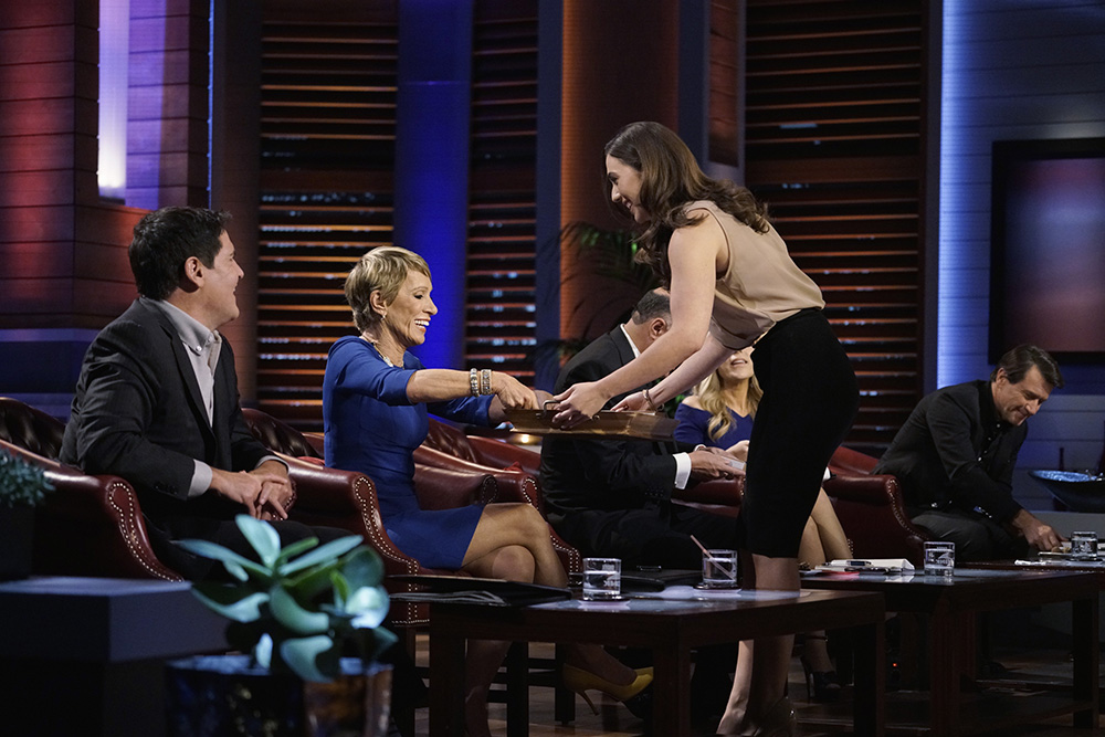 """SHARK TANK - """"Episode 726"""" - A woman from Boston, Massachusetts, hopes the Sharks will make a deal and sink their teeth into her chocolate treats that are perfect for women who want to satisfy cravings; a season four entrepreneur from Aeworth, Georgia, returns for a second chance to pitch the Shark's his new business, a line of men's hair products; a man from Telluride, Colorado, who is desperate for capital, plans to warm the Sharks' hearts with an app that allows users to electronically send handwritten cards; and a man from Boston, Massachusetts, believes he has created a unique way to break bad habits with self-zapping wristbands. Also, recaps and updates featuring the various entrepreneurs that appeared during season seven, on """"Shark Tank,"""" FRIDAY, MAY 20 (9:00-10:01 p.m. EDT), on the ABC Television Network. (ABC/Michael Desmond) MARK CUBAN, BARBARA CORCORAN, TANIA GREEN (PMS BITES)"""