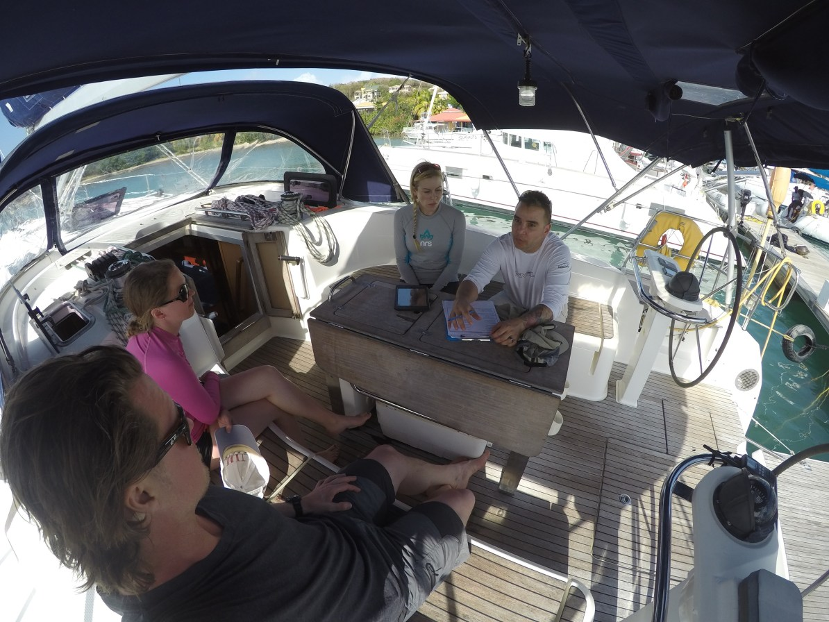 Captain Nestor doing the safety briefing with the crew