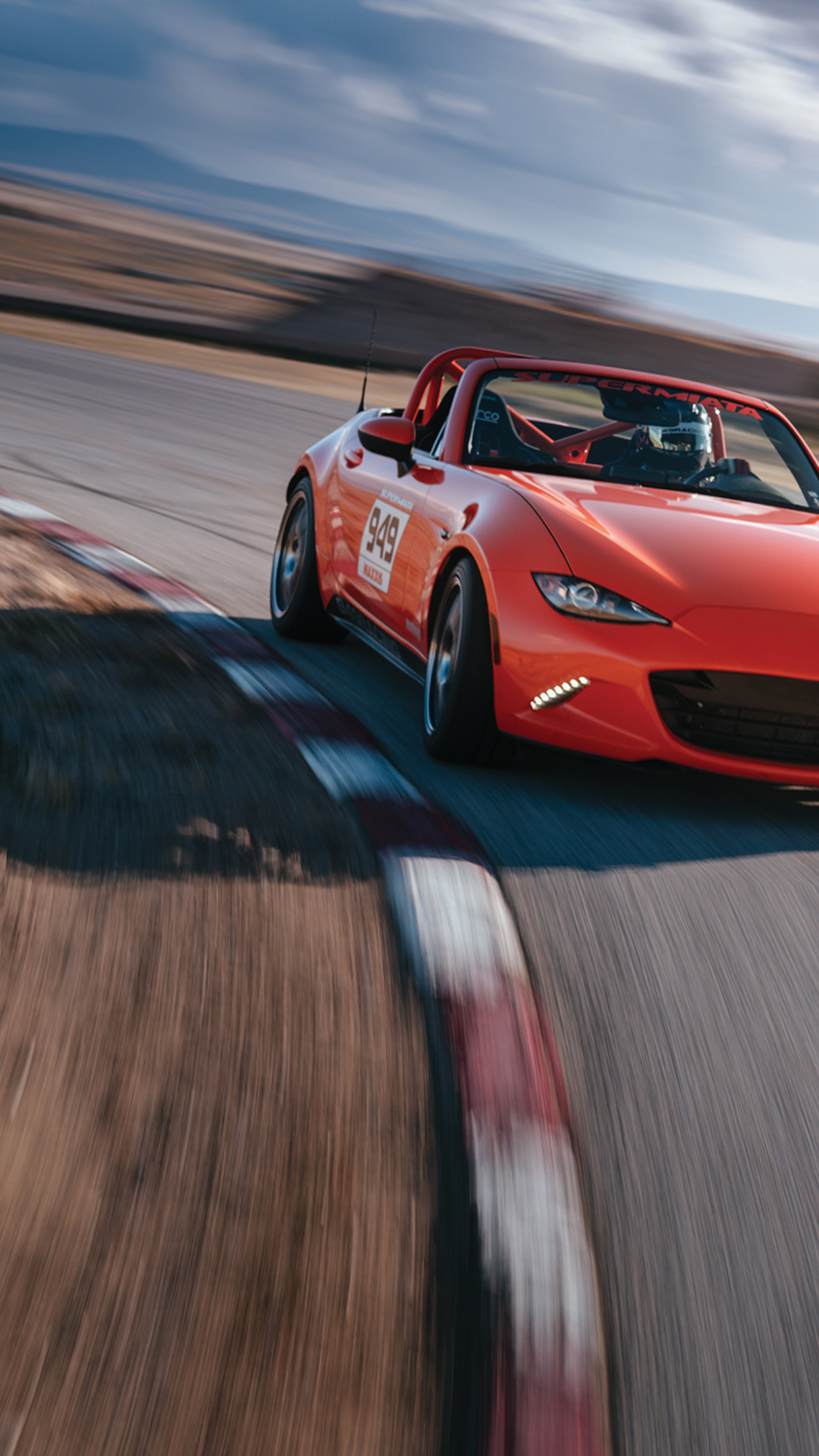 Car on racetrack with Maxxis Tires for marketing content campaign