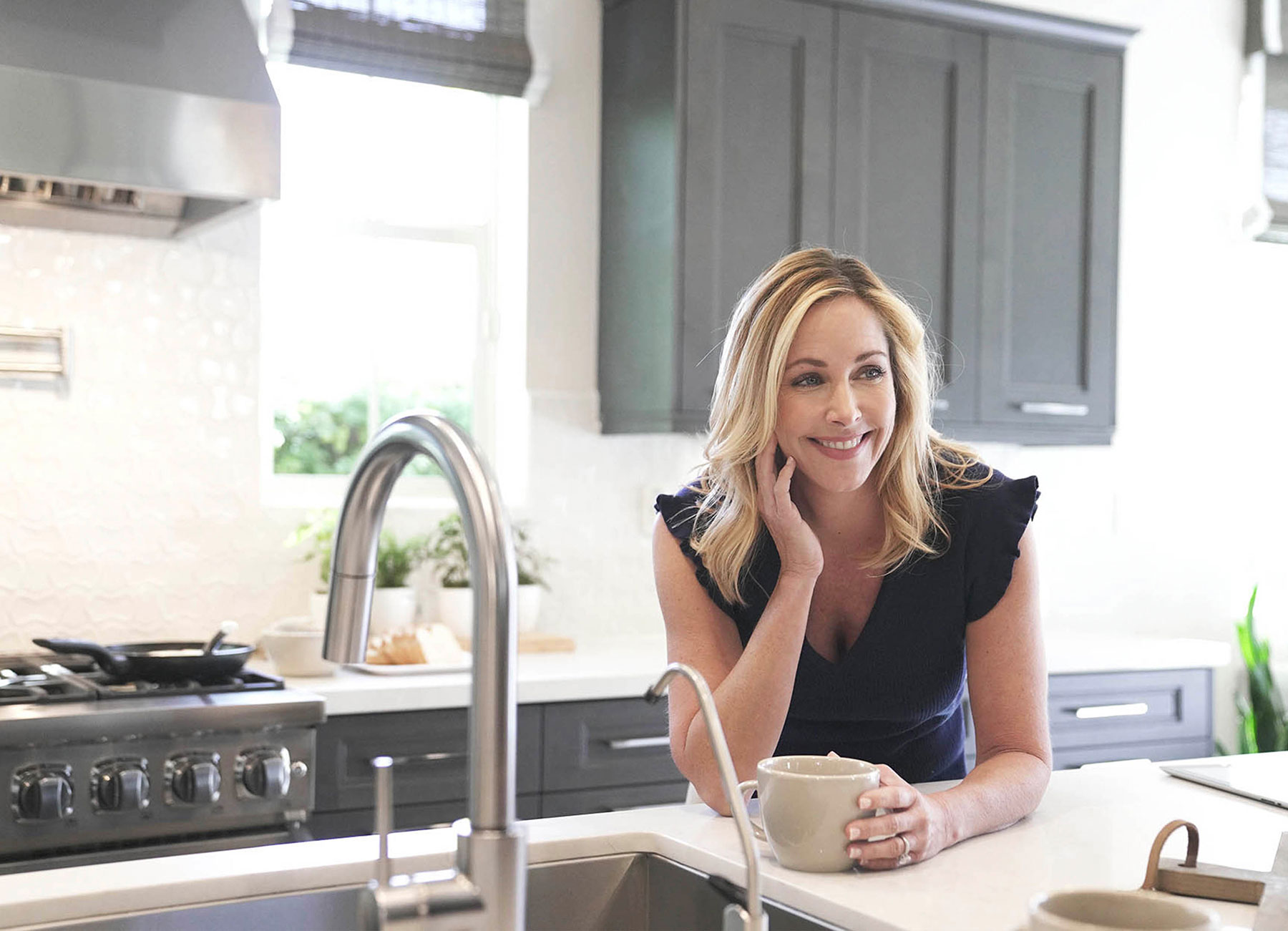 Women drinking coffee in real estate branding campaign