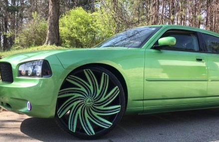 2010 Dodge Charger sitting on 26″ Black&Green Azara 502 wheels wrapped in 275/25-26 lexani tires in 1436 Baldwinville MA