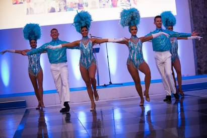 Blue and white showgirls and showboys