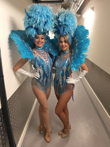 Showgirls in blue costumes