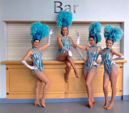Showgirls with blue headdresses
