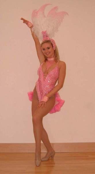 Showgirl in pink posing