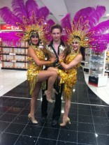 Showgirls and showboy in gold costumes