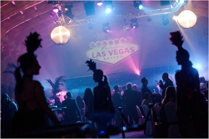 Showgirls in silhouette at a Vegas themed event