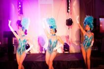 Showgirls performing in blue and silver costumes
