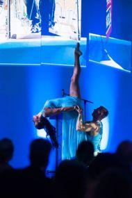 two dancers performing impressive lift
