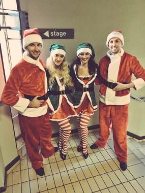 Dancers dressed as Santa and Elves