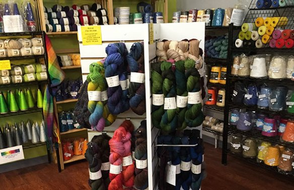 A corner filled with yarn for sale