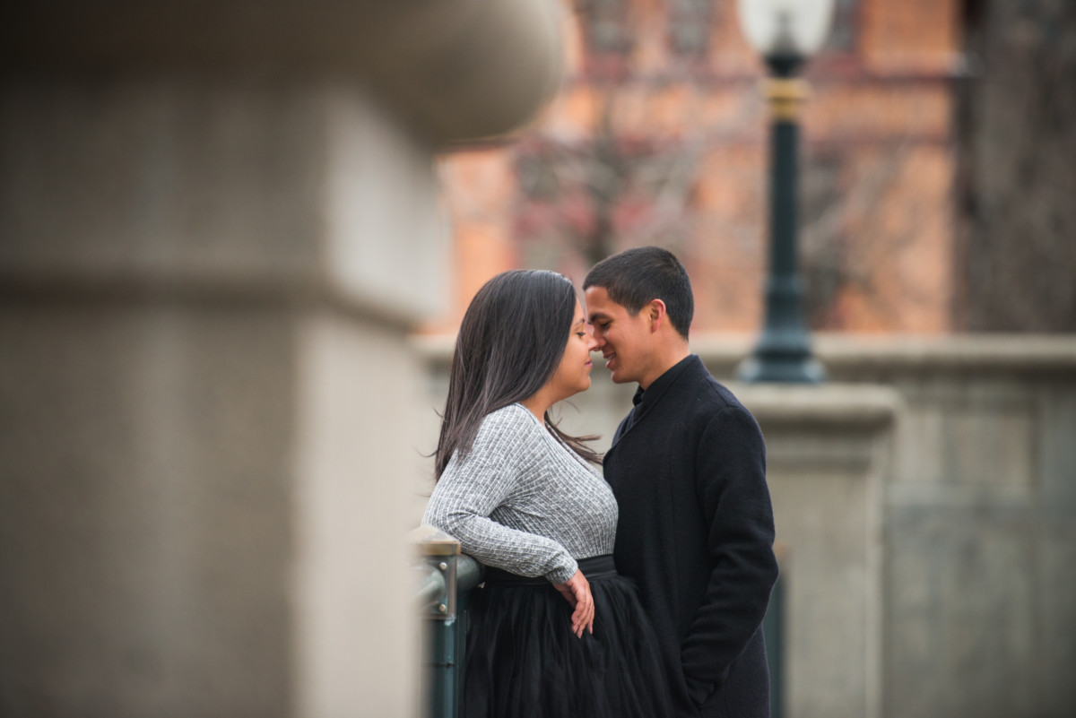 Downtown Providence Engagement - Kiss on the Waterplace park bridge