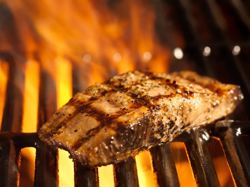 salmon fillet on the grill with flames