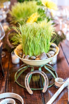 Country Look; Wheat grass with river rock, fugi mums, horseshoes