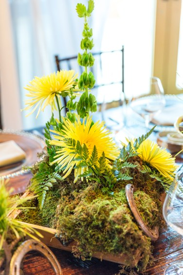 Fugi mums, bells of Ireland, greens and moss create this country look.