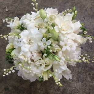 Gardenia, lily of the valley, stephanotis, garden rose and lisianthus. All White Bridal Bouquet