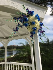 blue and white ceremony decor in roses, orhcids, and hydrangea