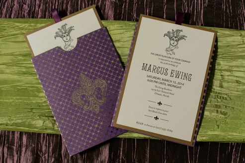 Custom stationary, beads, masks and stunning layers of linens complete this look of Mardi Gras