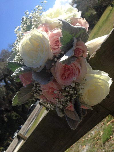 Bridal bouquet of garden roses, babies breath and dusty miller
