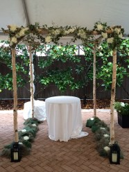 Birch wood Chuppah with antique lace, ivy and white floral