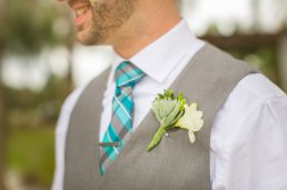 Grooms boutonniere of succulents and freesia
