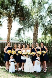 Beautiful wedding party in navy and white with yellow bouquets