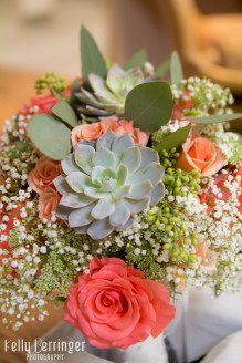 Succulents, seeded eucalyptus, peach spray roses, Queens Ann lace, babies breath, and Amsterdam standard roses