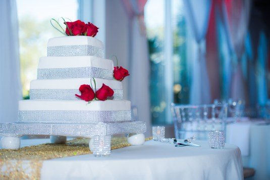 Bling cake with a few red roses at Heaven Event Center