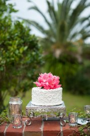 Beautiful mini cake with one single hot pink peony on top