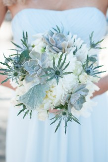 Thistle, succulents and dusty miller were used to compliment the light blue dresses