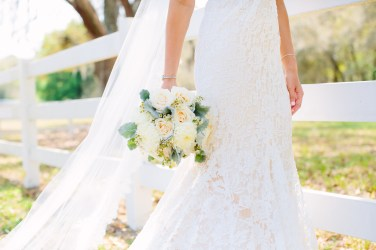 Bridal bouquet of gardenroses, dusty miller and wax flower
