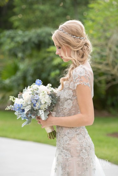 Stunning bridal bouquet with blue hydra, garden roses, delphenium and greens