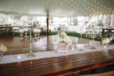 We paired our silver candelabras with our white wash boxes, filled with white Hydrangea, Euchs, and Juliets for elegant reception table decor.