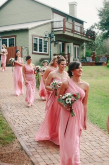 Dusty rose bridesmaids gowns carrying bouquets of anemone, burgundy and antique carnations, silver dollar eucalyptus with trailing burgundy velvet ribbons