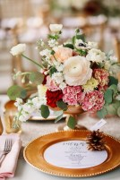 Centerpiece of garden style floral with antique and burgundy carnation, blush clooney rananuculus, white anemone, cushion mums, white stock and eucalyptus