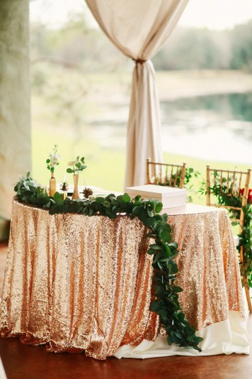 Sweetheart table with cascading garland and elegant chair back floral with Mr and Mrs