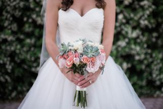 Bridal bouquet filled with Succulents, Blush Standard Roses, Peach Spray Roses, Dusty Miller, and White Lisianthus.