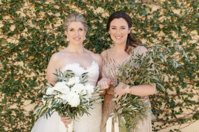 Our Bride and her Maid with their loose and airy textured bouquets with Olive Branches, Euchs, and white Ranunculus/Garden Roses/Peonies.