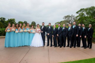 Our wedding party with their tropical floral designs of pinks, whites, and blues.